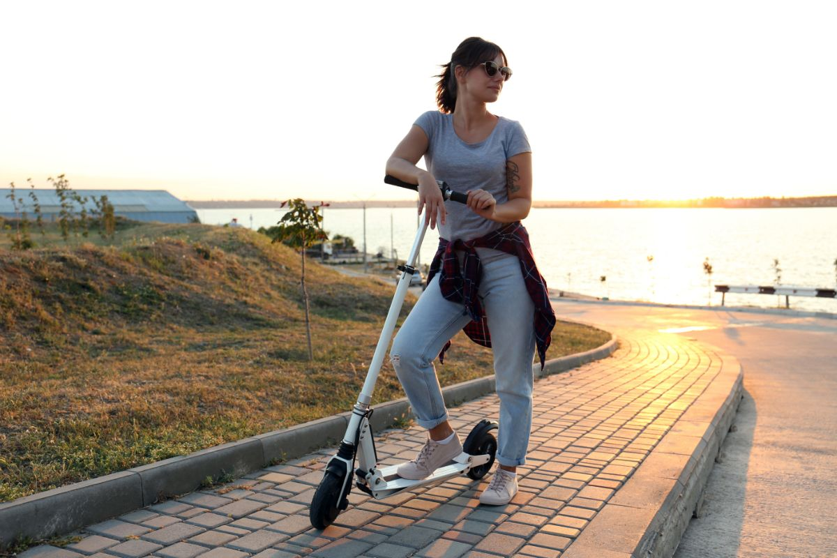 woman riding electric scooter