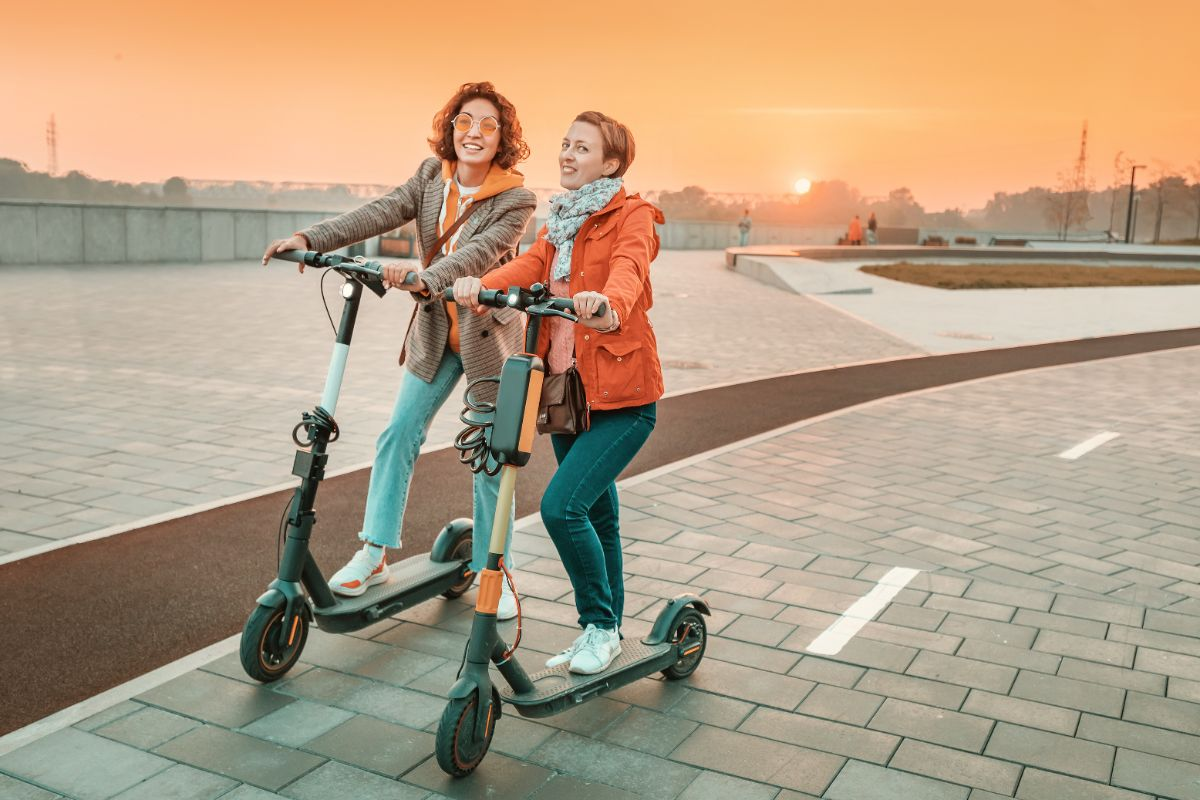 2 girls with electric scooter