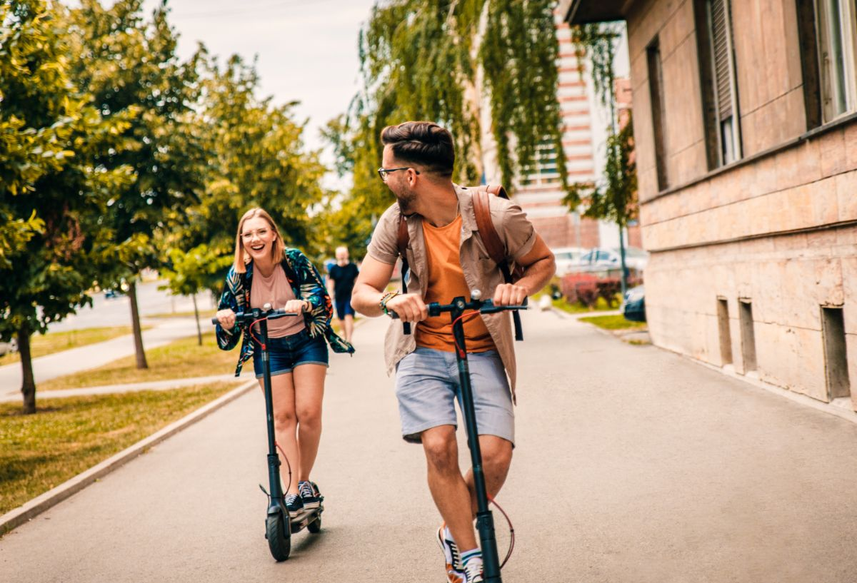 Couple riding on electric scooter