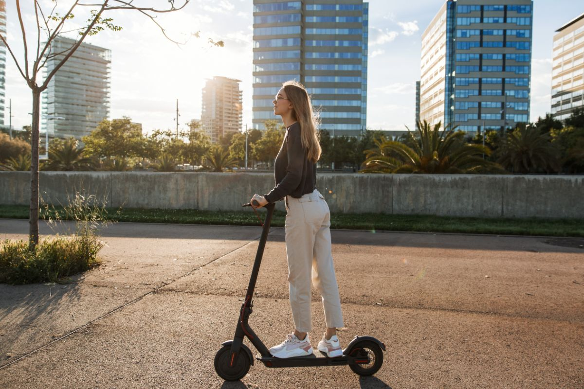 Pretty Girl riding electric scooter