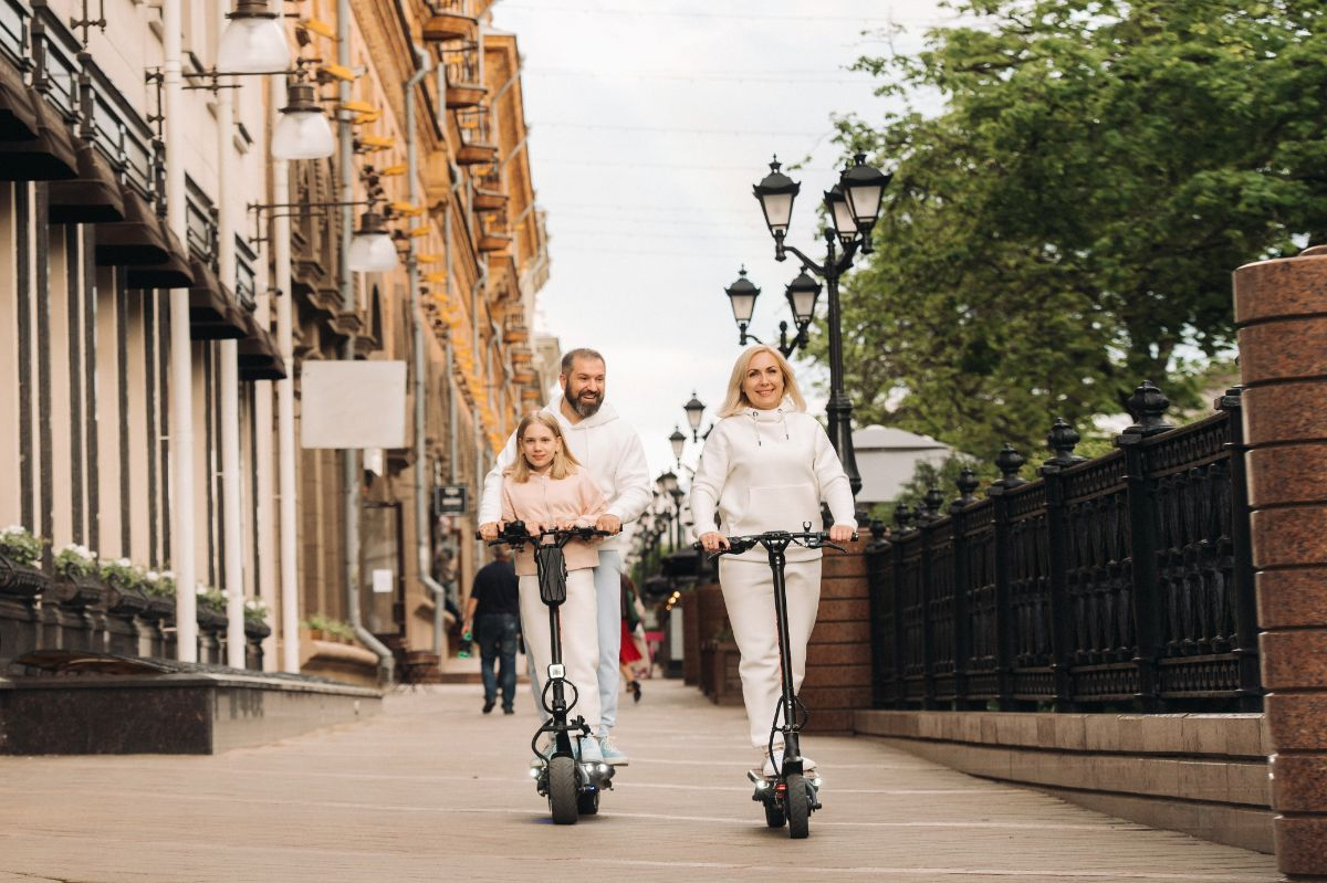 happy family riding electric scooter