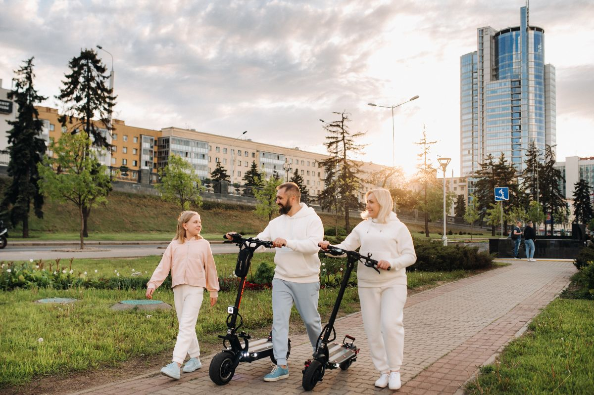 happy family with electric scooter