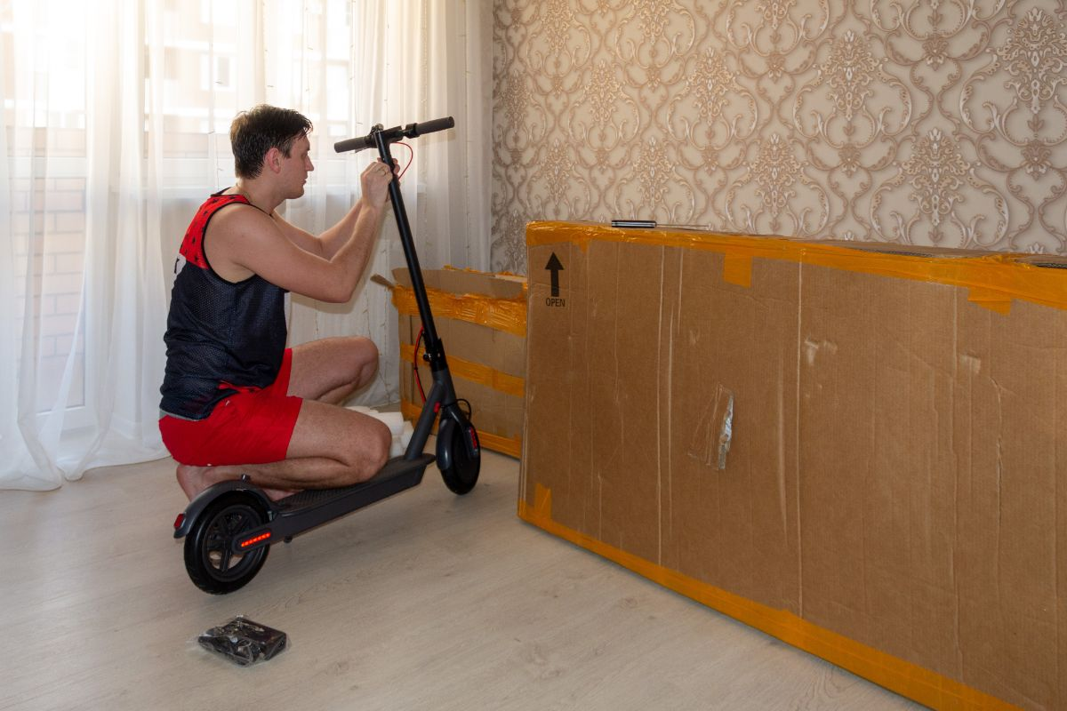 man finished assembling electric scooter