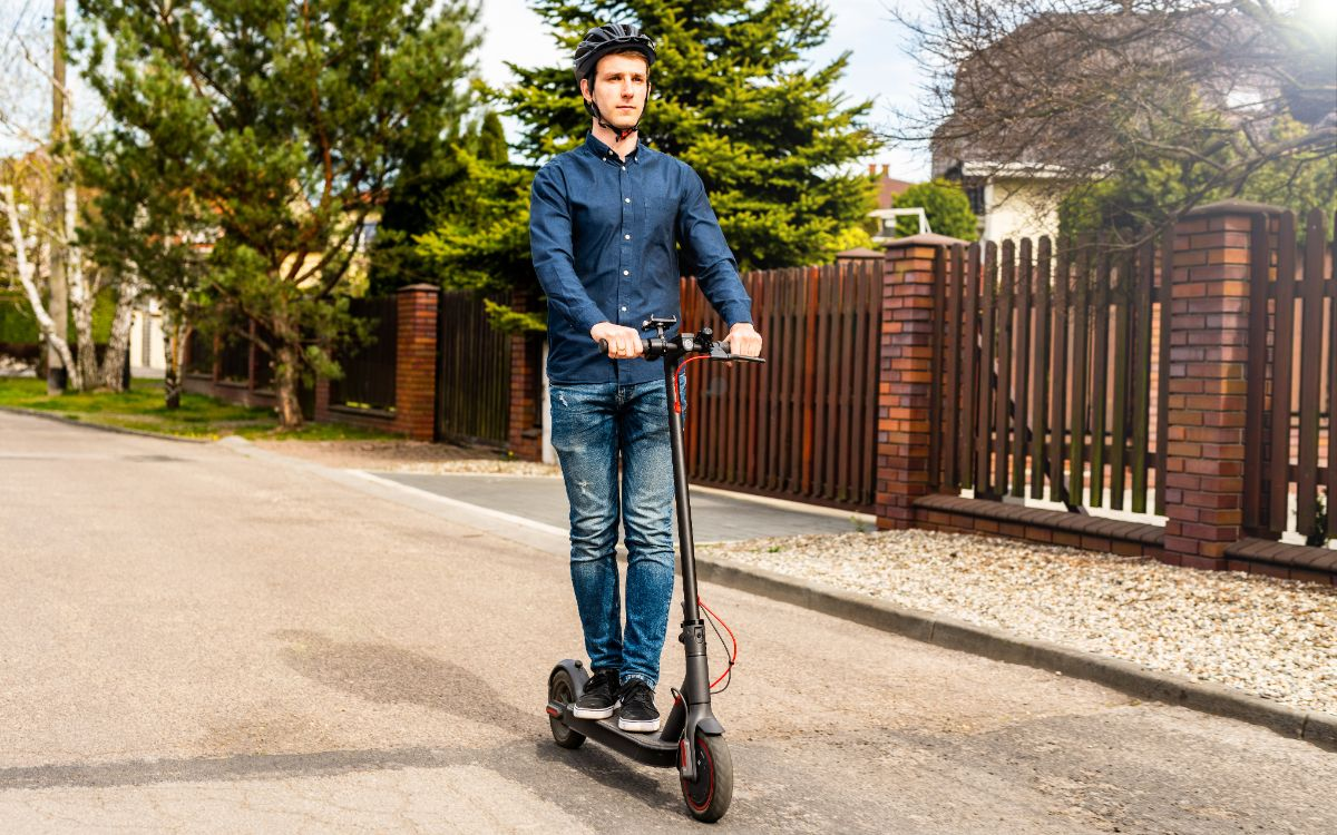 man riding on his electric scooter on the road