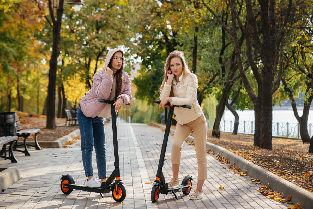 two girls with electric scooter