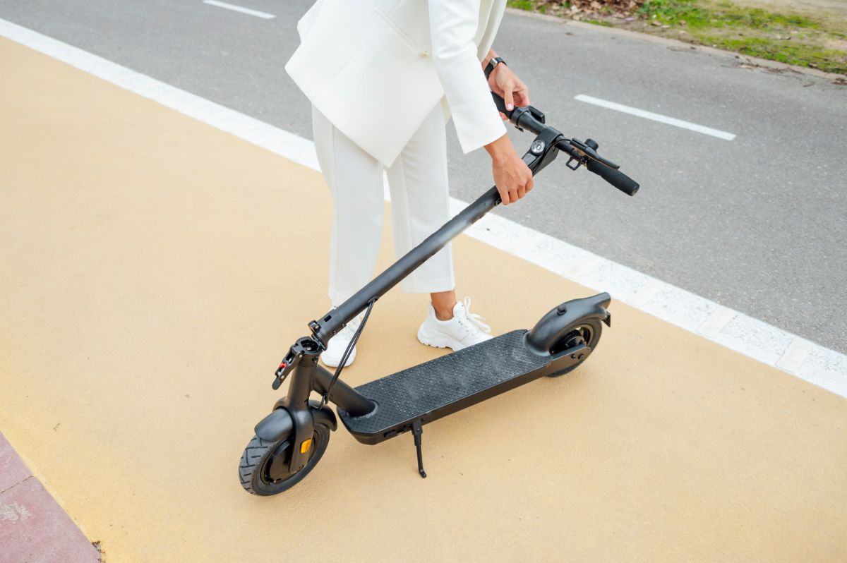 woman folding electric scooter
