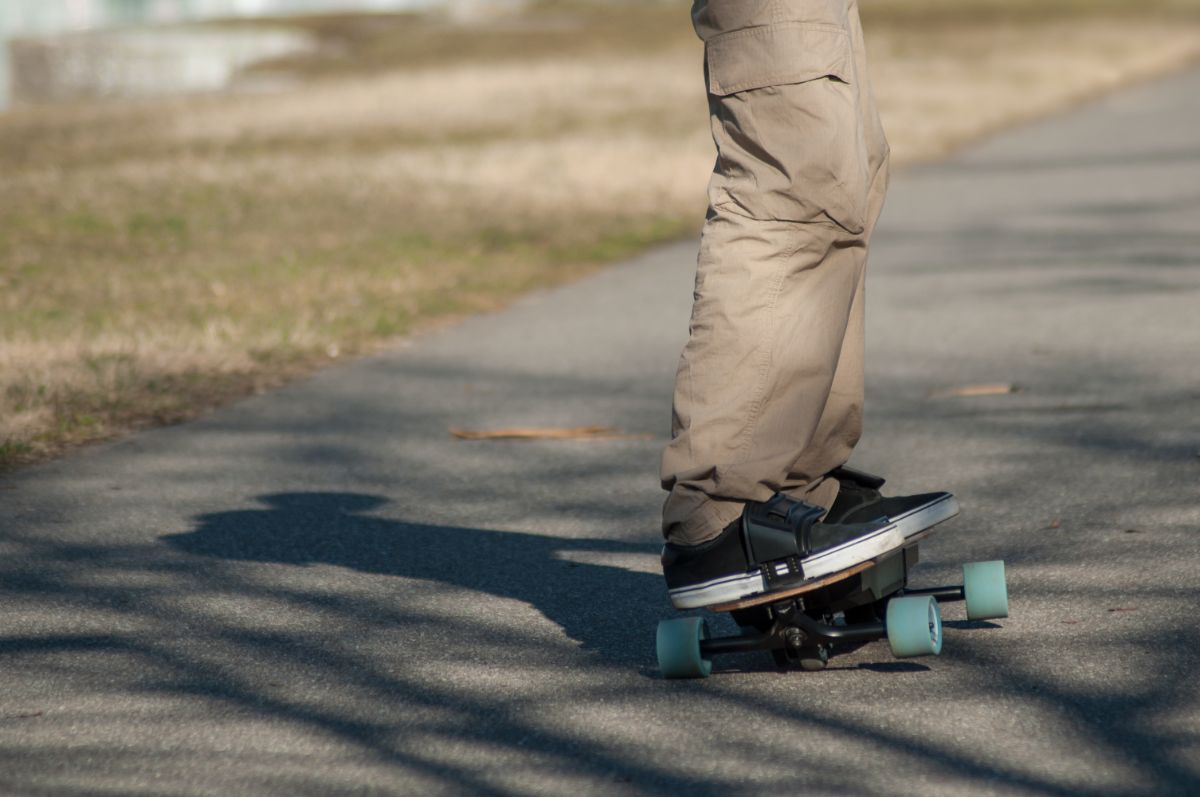 young man riding electric skateboard